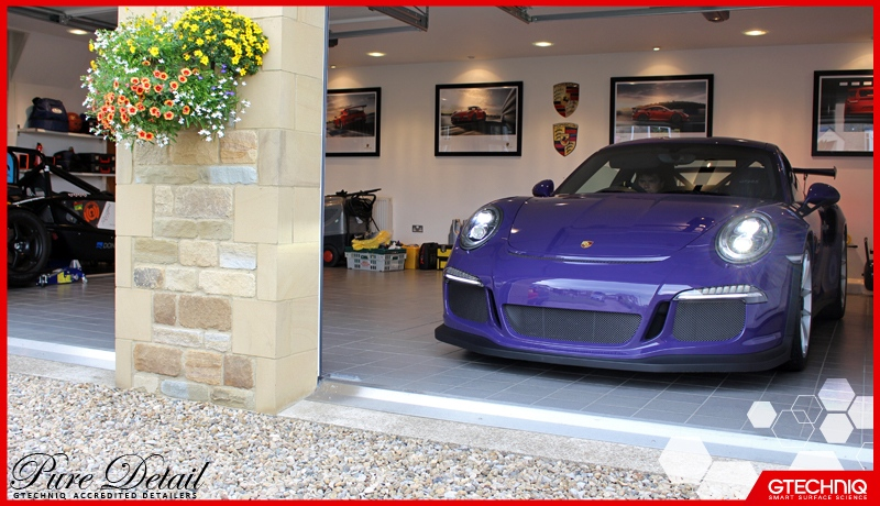 driver-and-car-at-one-gtechniq-protected-detailed-by-pure-detail-manchester-accredited-swirl-free-paint-correction-specialists